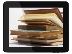 Tablet Computer And Books Stock Image By adamr, published on 24 July 2012 Stock Image - image ID: 10093750